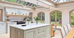 Kitchen Conservatory With Arched Doors.
