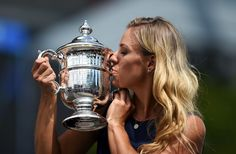2016 U.S. Open - Day 14 Angelique Kerber of Germany kisses her 2016 US Open Womens Singles champion trophy at the USTA Billie Jean King National Tennis Center in New York on September 11, 2016..New world number one Angelique Kerber won the US Open title on September 10, with a battling 6-3, 4-6, 6-4 victory over Karolina Pliskova of the Czech Republic. / AFP / Jewel SAMAD