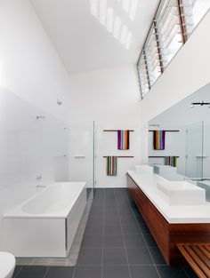 Drain around the bath. Wlate grey floor tiles, white wall tiles (prefer subway) with wood accents.