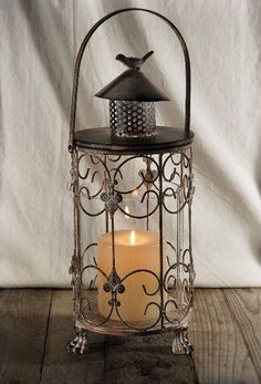 Whimsically illuminate a table with this rustic metal candle lantern with glass insert. The rustic lantern is tall and wid. Lanterns Decor, Candle Lanterns, Tea Light Candles, Tea Lights, Hanging Candles, Candleholders, Candlesticks, Paper Lantern Lights, Lantern Lamp