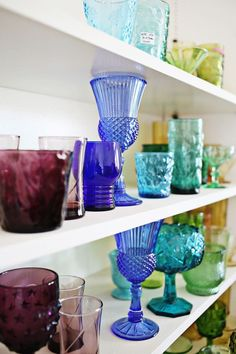 Today, I'm excited to share the progress I'm making on a rainbow glassware display in our breakfast nook. If you watched my empty home tour, you might remember that this rainbow glassware display was