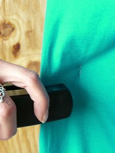 "Taking in a huge teeshirt? Hate pinning? Turn it inside out and have a friend staple around the edges until it fits. Sew 1/2"" INSIDE the staples and then trim off excess. Fast!"