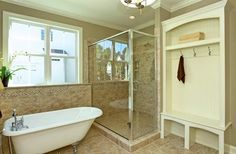 Claw Foot Tub and Shower, Master bath of the St. James by Homes by Dickerson (great idea with the bench and hooks in a bath)