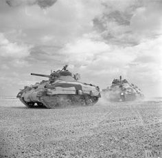 Sherman II tanks of the Queen's Bays (2nd Dragoon Guards), 2nd Armoured Brigade, moving up to the Alamein line, 24 October 1942.