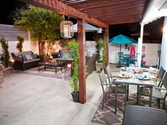 Cool pergola look against house - we could do this