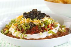 Serve our Ultimate Seven Layer Dip at any party for a savory sample of flavor. With sour cream, zesty salsa and cheese, our seven layer dip… Kraft Recipes, Dip Recipes, Mexican Food Recipes, Cooking Recipes, Ethnic Recipes, Kraft Foods, Mexican Dishes, Snack Recipes, Vegetarian Cooking