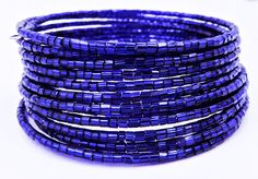 This dazzling sapphire blue wrap bracelet is made on 13 rows of silver memory wire and adorned with silver lined glass beads for a sparkling cuff bracelet that looks beautiful with anything!   ★ Return to my main shop page here for more inventory ★ www.etsy.com/shop/bridgetollbeading  ★ Read my FAQs below and if you have any further questions please do not hesitate to contact me! ★ https://www.etsy.com/shop/BridgeTollBeading?ref=hdr#more-section
