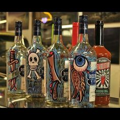 Cool pin stripe bottles i drink rarely, but these would still be fun to own.