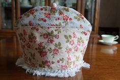 Shabby Chic Blue and Cream Rose Floral Print Insulating Fabric Tea Cosy / Cozy with Fringe Trim and Custom Polymer Clay Bead Pull Top $50.00 CAD