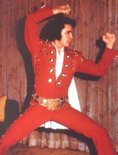 Elvis in his suite at the Las Vegas Hilton, 1972, preparing to go on stage.