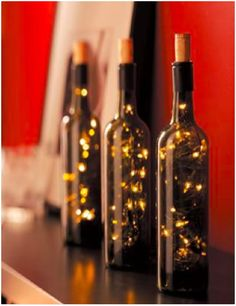 Fairy Lights in Wine Bottles.  Step One - Drink the wine.  If you drill a hole for the lights, you will make a terrible mess if it is a full bottle of wine.  :)