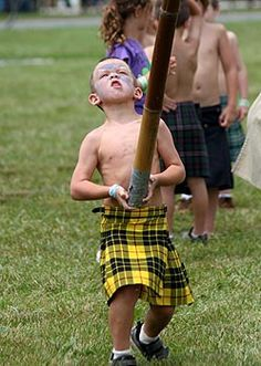 A young boy takes part in the Grandfather Mountain Highland Games Children's Caber Toss, Linville, North Carolina, United States, 2011, photograph by James Shaffer. The GMHG is a not-for-profit American organization that aims to foster and restore interest in traditional dancing, piping, drumming, athletic achievement, music, and Gaelic culture associated with Scottish life and history.