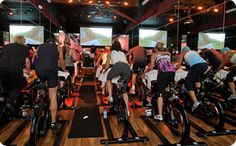 Sweet freakin spin class I wish my spin class had a video projector