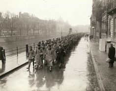 Prisoners of War from the German Military Police force and Gestapo agents of the city of Strasbourg are led to the 3rd Infantry Division