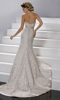 Lace fitted wedding dress. One I can consider.