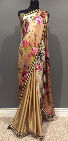 A Fashionkali exclusive design. Unique and glamorous in all ways.  Heavenly half half saree in floral satin print and plain gold satin or black satin
