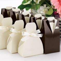 Add a classic touch to your reception table with these elegant tuxedo and bride favor boxes.