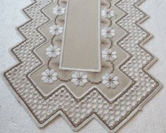 The edging on this piece includes a small stitch that sets off the hardanger beautifully.