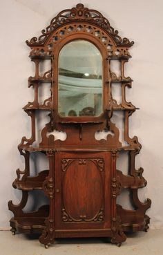Rosewood grain rococo etagere signed.
