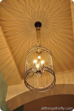 Love the uses for old Bird cages! Look at the light design on the ceiling!