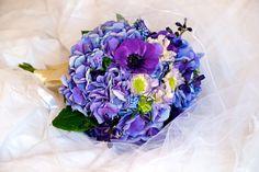 Blue hydrangea, purple anenome, muscari, delphinium, and blue scabiosa.