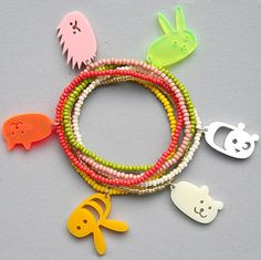 Cute friendship bracelets made out of small glass beads with lucky chain made out of acrylic glass.    Easy tho send as a present.  All bracelets are handmade fair trade in Africa.
