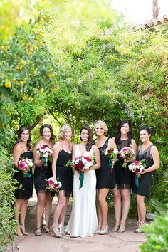 Black bridesmaids dresses | The bride asked her six bridesmaids to wear a LBD of their choosing with a 1930s or 1940s feel.