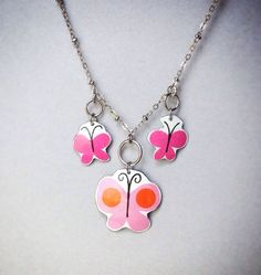 Each piece is hand cut from a metal 1960s toy sand pail. More Indie designer jewelry from Cellar Door Shoppe on Etsy.