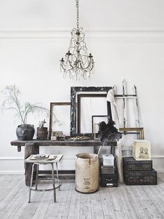 Black and white design and bohemian decor with rustic accessories, empty picture frames, romantic chandelier, and vintage collection. Hannah Lemholt Photography and Interior Design. Decoration Inspiration, Interior Inspiration, Workspace Inspiration, Interior Styling, Interior Decorating, Interior Design Photography, Decorating Ideas, Empty Frames, Deco Boheme