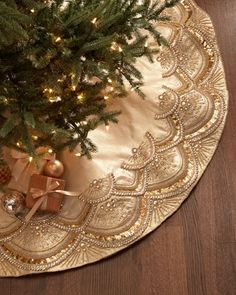 """looking like an exquisitely beaded ball gown, this handcrafted, beaded taffeta Christmas tree skirt is a masterpiece of craftsmanship that is destined to become a treasured keepsake. Handcrafted of plastic and glass beads on polyester taffeta fabric. $645. 64""""Dia"""