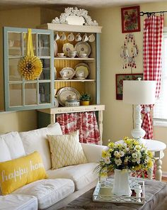 Yellow and red cottage style living room decor - love how cheerful and colorful this is!  Bright colors, mixture of patterns, red buffalo checks...so cute.
