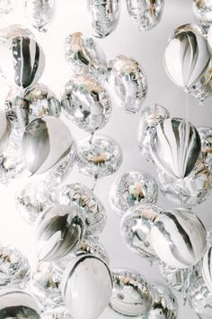 Silver balloons - could be idea for an elegant wedding reception or a corporate event.