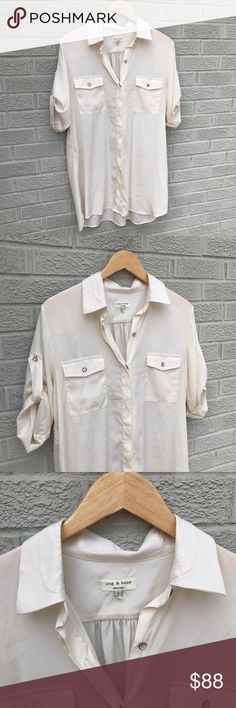 """Rag & Bone Longline Button Down Silk Top Rag & Bone Longline Button Down Silk Top with convertible sleeves! Love this Ivory color & long length! A perfect staple piece! Love the gathered back! Flap pockets at the chest & hidden front buttons. Size Large. 22"""" across the chest & 30.5"""" Long in front & 33"""" in the Back. Previously loved. Small imperfection on the left bottom section. See pics. BR1734091517 rag & bone Tops Button Down Shirts"""