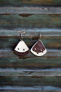 purchase effect... handmade leather earrings from thailand. $14 https://www.pinterest.com/latiendinaastur/leather-cuero/