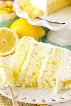Lemon Mascarpone Layer Cake - a light lemon cake with lemon curd filling and whipped mascarpone frosting! Delicious!