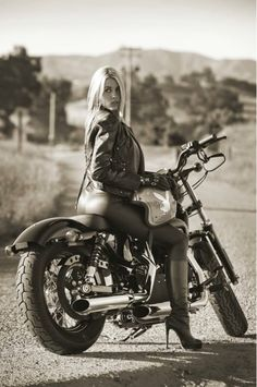 Motorcycle Girl Photo of Playboy Playmate Heather Rae Young Wearing a Leather Motorcycle Jacket, High Leather Boots and a Playboy Motorcycle Helmet - Sitting on a Harley-Davidson