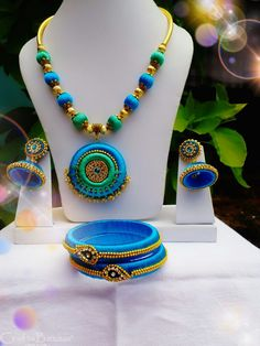 This is a multicolored (blue, green and yellow) beautiful necklace set with earrings and bangles. The neckpiece is made using silk thread plastic and wooden moulds. It has an adjustable cord. Colors can be customized accordingly. Appropriate for festive occasions. #craftsofindia #indianhandicrafts #madeinindia #craftsbazaar #artsandcrafts #handmade