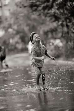 rain by Alena Vlasko, via 500px  Makes me think of G...we have a rule that we never pass a puddle without jumping in it!!  :)