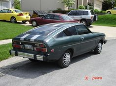 1977 Datsun B210 - Mine was white with blue racing stripes. Somehow, this car looks cooler now than it did when I was in high school!