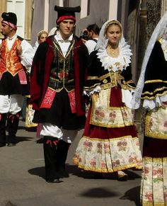 Traditional costume of Italy (Sardinia) costume of their decor with a lot of fabric, detail embroidery.It looks like royal oufit.
