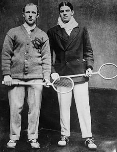 Squash players with their wooden racquets.