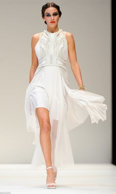 She's got it! The greek goddess motif continued, using a structured bodice and detail to create a modern interpretation of the traditional flowing white dress