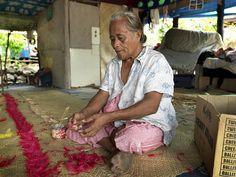 Leatu Tausaga from Manono Island, Samoa, weaves a traditional Samoan fine-mat