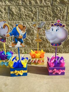 Beauty and The Beast Centerpieces for birthday or any themed event  If you would like to purchase just ONE centerpiece, you can purchase here...  https://www.etsy.com/listing/236415572/beauty-and-the-beast-birthday?ref=shop_home_active_1  ALSO AVAILABLE NOW, IS A LOLLIPOP/COTTON CANDY STAND. YOU CAN VIEW HERE...  https://www.etsy.com/listing/259063541/princess-birthday-lollipop-or-cotton?ref=shop_home_active_1  CAN BE MADE IN ANY THEME. SEND ME A MESSAGE TO GET YOUR THEME!  *****IMAGE AND…