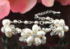 "Bridal Bracelet Wedding Bracelet Bridal by goddessdesignsgems, $59.00 ""Fabulous and absolutely stunning "" this gorgeous bracelet is completely hand-wired and features an amazingly beautiful design with an array of sparkling clear Swarovski crystals,silver embellishments and genuine ""Freshwater"" pearls making it so incredibly beautiful. The detail and workmanship in this bracelet is truly spectacular!"