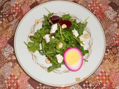 Arugula, Goat Cheese, Beets, Toasted Hazelnuts and Pickled Egg.