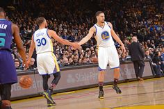 Stephen Curry and Klay Thompson of the Golden State Warriors high five during the game against the Charlotte Hornets on February 1 2017 at ORACLE...
