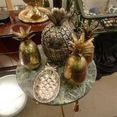 Assorted brass pineapple ice buckets, 1950s - 1960s. Offered by Louise Verber at Alfies Antiques.