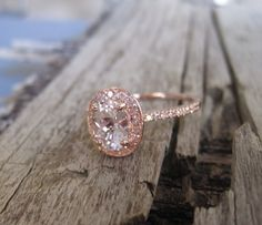 1.11 Cts. Diamond White Sapphire Halo Engagement Ring in 14K Rose Gold. $1,095.00, via Etsy.