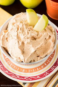 A fluffly Pumpkin Dip is delicious served with apples. Recipe by deliciouslysprinkled.com